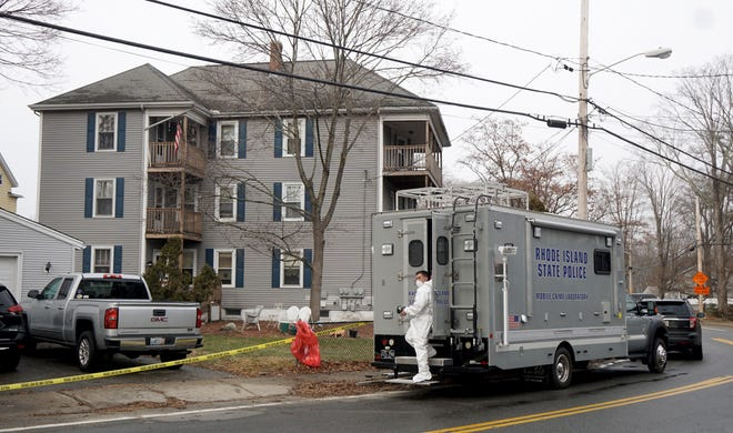 A state police mobile crime lab is parked outside 125 Main St. in the Manville section of Lincoln on Thursday afternoon. [The Providence Journal/Kris Craig]
