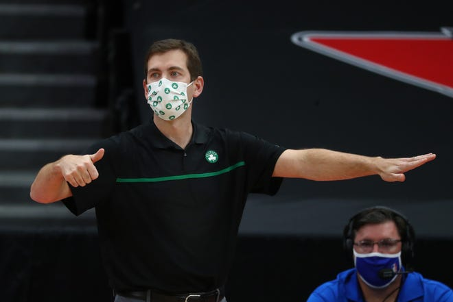 """""""I don't think there's an easy answer here,""""  Celtics coach Brad Stevens says about trying to play games during the COVID-19 pandemic. Boston is expected to return to the court Friday night."""