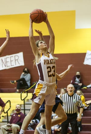 Southeast senior Jenna Call goes up to snag a rebound during Wednesday night's game against Rootstown High School.