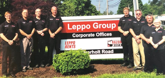 Leadership Team opening Leppo Group's Kent corporate offices two years ago includes Mike Leppo, Dale Leppo, John Stride, Dan LeBeau, Glenn Leppo, Ed Radel, Jeff Ulman, Erin Palmer.