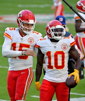 Kansas City Chiefs wide receiver Tyreek Hill (10) celebrates his touchdown against the Miami Dolphins with quarterback Patrick Mahomes (15) during the second half at Hard Rock Stadium.