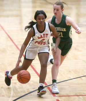McKinley's Paris Stokes (2) of McKinley brings the ball up court while being guarded by GlenOak's Keely Burke (21) during Wednesday's game.