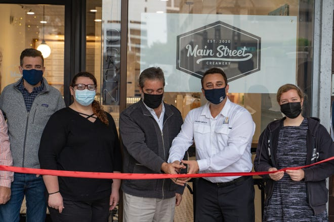 Ice cream shop Main Street Creamery is now open in downtown Sarasota, with Mayor Hagen Brody, second from right, attending a ribbon cutting on Wednesday.