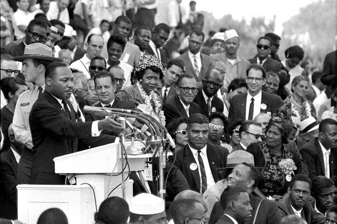 """In this Aug. 28, 1963, photo, the Rev. Dr. Martin Luther King Jr., head of the Southern Christian Leadership Conference, speaks to thousands during his """"I Have a Dream"""" speech in front of the Lincoln Memorial for the March on Washington for Jobs and Freedom, in Washington. King was born on this date in 1929 in Atlanta."""