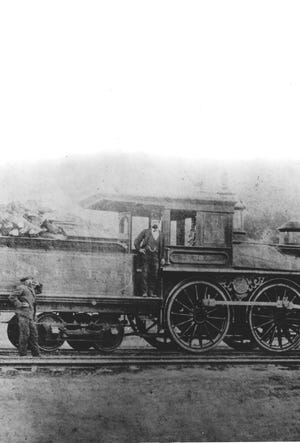 A locomotive sits on the Wilmington and Weldon Railroad line outside of Wilmington. Look at the faintly visible W & W on the train car's side.
