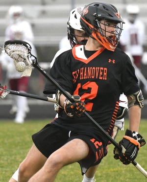 New Hanover's Grant Duffy looks to pass off the ball as Ashley took on New Hanover last season. Duffy is one of three New Hanover seniors who will miss out on their final boys lacrosse season as the Wildcats won't field a team in 2021 due to the new NCHSAA calendar.
