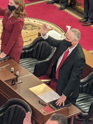 Steve Tyson is pictured taking the oath of office to the NC House Of Representatives at the Legislative Building in Raleigh. He chose to officially be sworn in last week at the Tryon Palace on Jan. 7 to make the ceremony available to the citizens of New Bern and Craven County, whom he will represent. The ceremony at the legislative building in Raleigh was to honor all 120 House members, elect the Speaker of The House, and appoint the various committees chairs. [CONTRIBUTED PHOTO]