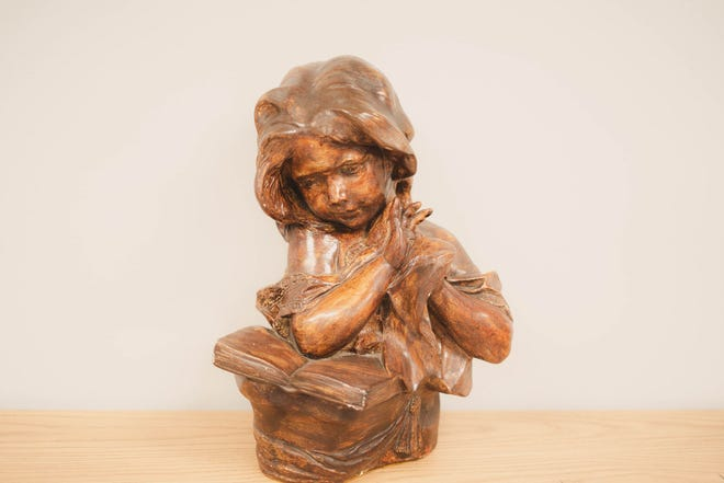 This statue is one of the many items available at this month's Habitat InStore Auction for January. [CONTRIBUTED PHOTO]