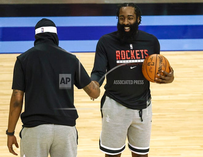 Houston Rockets guard James Harden, right, talks with Los Angeles Lakers forward Markieff Morris before an NBA basketball game Tuesday, Jan. 21, 2021, in Houston.