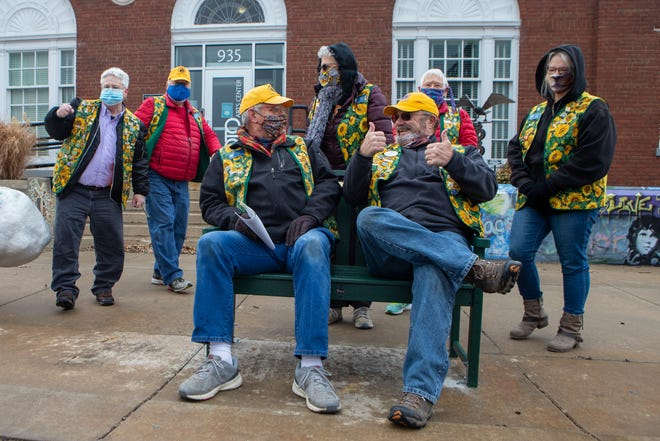 Members of the Sunflower Lions Club of Topeka smile and give thumbs up after testing out their new bench Thursday in front of the NOTO Arts Center, 935 N. Kansas Ave. The club installed the bench as a challenge by Trex to collect 500 pounds of stretchable plastic.