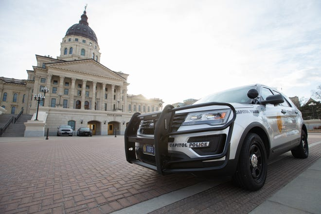 A Kansas Highway Patrol Capitol Police unit sits outside the Kansas Statehouse.
