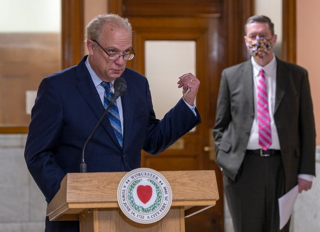 Mayor Joseph M. Petty gestures towards City Manager Edward M. Augustus Jr. during the city's weekly COVID-19 update Thursday at City Hall.