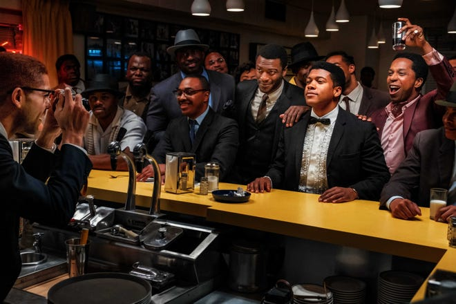 """Malcolm X (Kingsley Ben-Adir, at left) takes a picture of his friends Jim Brown (Aldis Hodge), Cassius Clay (Eli Goree) and Sam Cooke (Leslie Odom Jr.) in """"One Night in Miami."""""""