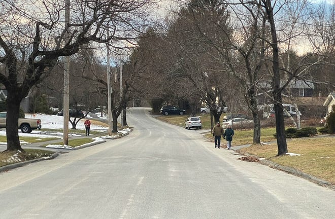 Residents walk along Dick Drive on Worcester's West Side, days after a shot fired in the neighborhood left some folks there on edge.