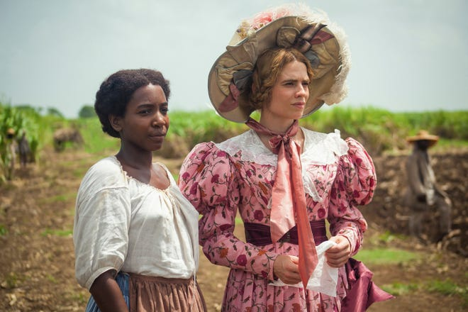 "Tamara Lawrance, left, and Hayley Atwell in a scene from the miniseries ""The Long Song"" debuting Jan. 31 on ""Masterpiece."""