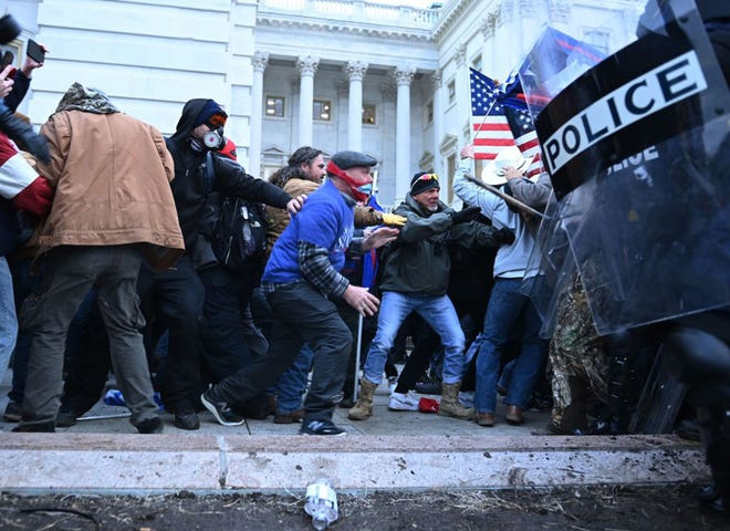Trump supporters clash with police and security forces, as they storm the US Capitol in Washington, D.C., on Jan. 6. Demonstrators breeched security and entered the Capitol as Congress debated the 2020 presidential election Electoral Vote Certification.