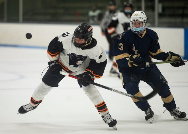 Marlborough's Marcus Chrisafideis (left) and Shrewsbury's Matthew Nuzzolilo chase the puck during the game on Jan. 13, 2021. Chrisafideis scored three times in a win over Wachusett on Monday.