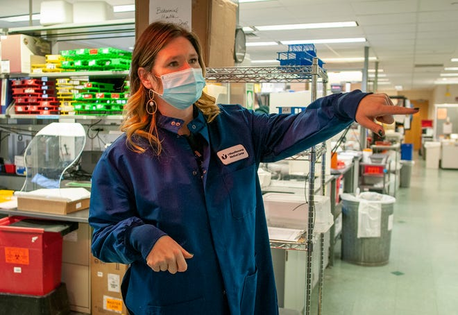 Jessica Gatulis, manager of business in lab operations at UMass Memorial, gives a tour of a laboratory.