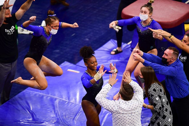 Florida's gymnasts celebrate after beating Auburn last week at Auburn Arena.