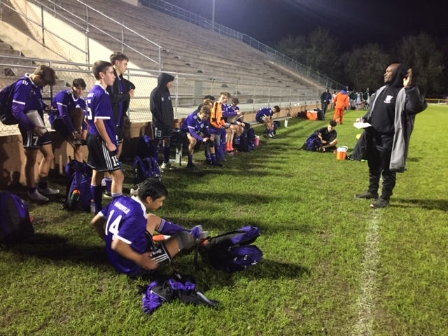 Gainesville High boys soccer coach Basil Benjamin talks to his team after their 1-0 win over Eastside at Citizens Field. The Hurricanes will defend their Alachua County Cup title Friday against Santa Fe.