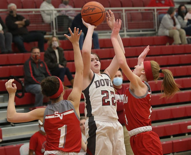 Dover's Tori Jones shoots a three pointer over Sandy Valley defenders Zoe Ward and Lexi Tucci Wednesday night.