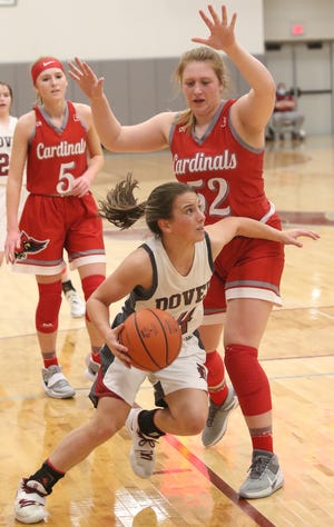 Dover's Addie Martin drives to the hoop as Sandy Valley's Abby Parker defends Wednesday night.