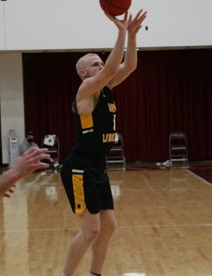 Indian Valley graduate Dalton Bolon fires up a shot Wednesday night.
