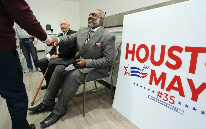 Former Alabama football coach Gene Stallings was on hand to introduce one of his former players, Martin Houston, as he began his bid to become Tuscaloosa's mayor, Jan. 14, 2020. Houston greets a supporter backstage before the press conference. [Staff Photo/Gary Cosby Jr.]