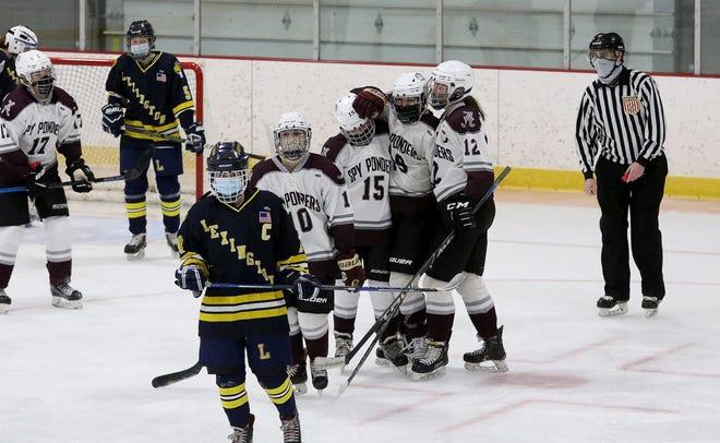 The Arlington girls hockey team celebrated Madeline Krepelka's goal, which put the team on the scoreboard against Lexington, Jan. 13, 2021. Arlington dominated, winning 11-1.