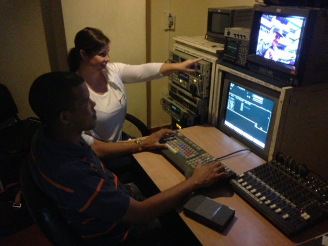 """Ellen Farmer working with an editor in Havana, Cuba to pull footage for their PBS show """"The Fidel Castro Tapes."""""""