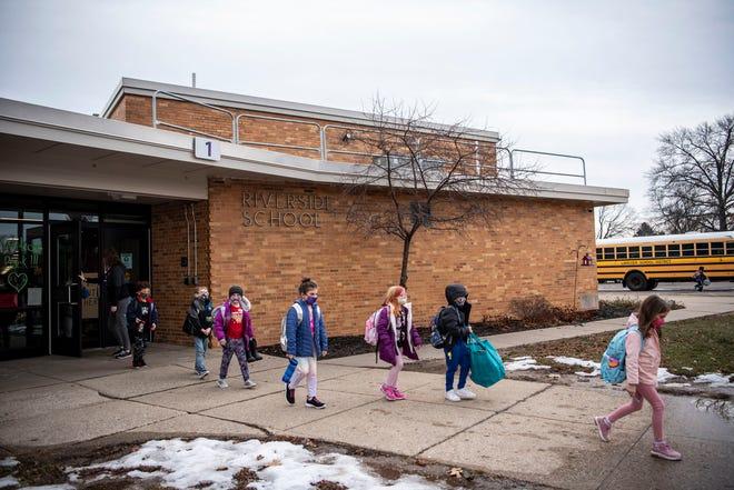 Lakeview Riverside Elementary students leave school on Thursday, Jan. 14, 2021 in Battle Creek, Mich.