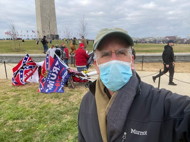 Rep. Peter Welch, D-Vt., takes a selfie near the Washington Monument in Washington, D.C., while supporters of President Donald Trump stand with flags on the morning of Wednesday, Jan. 6, 2021, before the president spoke at a rally falsely claiming election fraud stole a second term from him. Rally attendees later stormed the U.S. Capitol trying to disrupt the certification of Joseph Biden as president-elect, leading to five death and destruction.