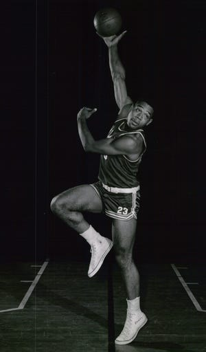 A statue capturing Wayne Embry's  likeness, similar to this 1958 photo featuring his signature hook shot will become the first honoring an African American alumnus at Miami University.