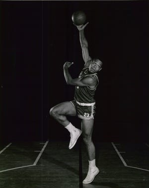 1958: Miami University basketball player Wayne Embry, #23.