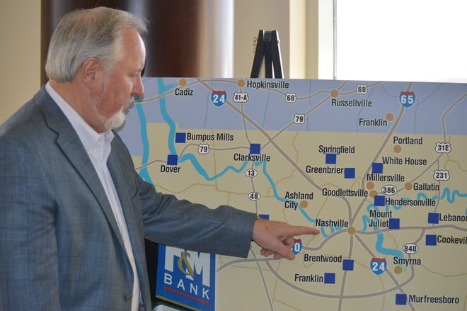 F&M Bank President Sammy Stuard pinpoints the location of the bank's next full-service branch on a map. F&M is expanding its reach into Nashville.