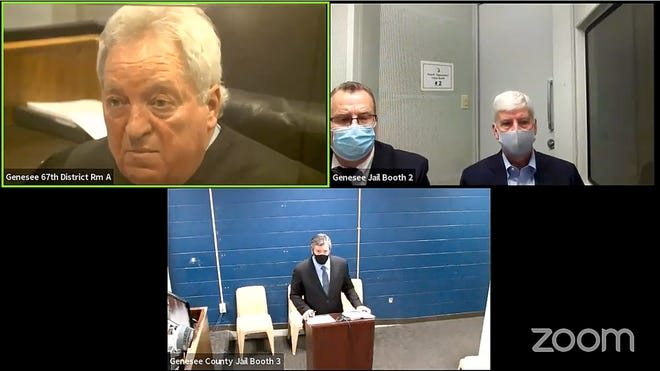 Former Michigan Governor Rick Snyder appears in court with his attorney Alexander Rusek, left via Zoom in Judge Christopher Odette's courtroom facing two counts of willful neglect of duty by a public officer in the 67th District Court in Genesee County on January 14, 2021.