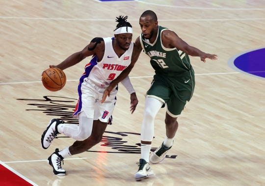 Piston forward Jeremy Grant repels Bucks forward Chris Middleton during the first quarter on Wednesday January 13, 2021 at the Little Caesars Arena.