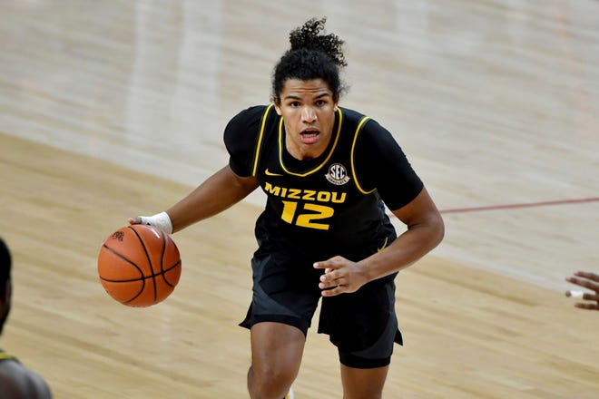 First-team all-SEC selection Dru Smith (12) will lead Missouri against Oklahoma at 6:25 p.m. Saturday in the first round of the NCAA tournament at Lucas Oil Stadium in Indianapolis.
