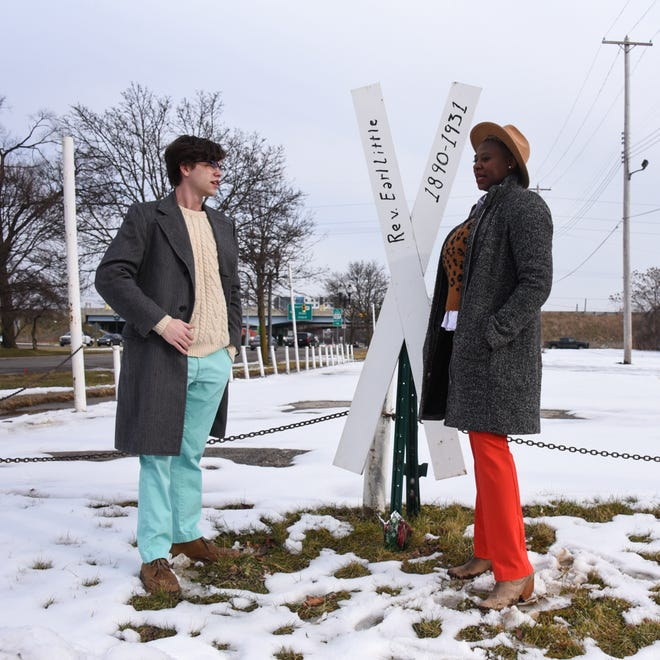 Edmund Rushton and Krystal Rose-Davis at the corner of Detroit Street and East Michigan Avenue, Thursday, Jan. 14, 2021, near the spot where Malcolm X's father, the Rev. Earl Little was said to have died in 1931.