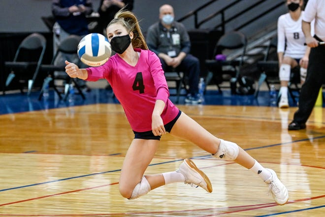 Lakewood's Carley Piercefield dives and hits the ball during the second set of the match against Pontiac Notre Dame Prep on Thursday, Jan. 14, 2021, at the Kellogg Arena in Battle Creek.