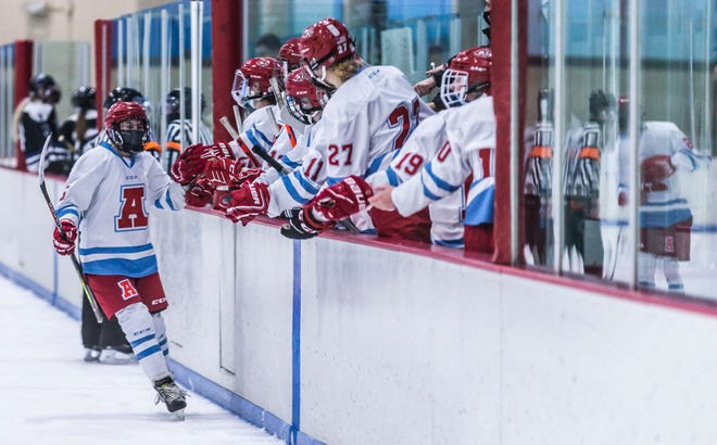The Arrowhead girls hockey co-op celebrates in January after scoring on the Lakeshore Lightning co-op team. In Michigan, young people are clearly driving the latest surge in COVID-19, likely because they are tired of precautions and more vulnerable to the new variant. Youth sporting events and school-based outbreaks have been the major culprits.
