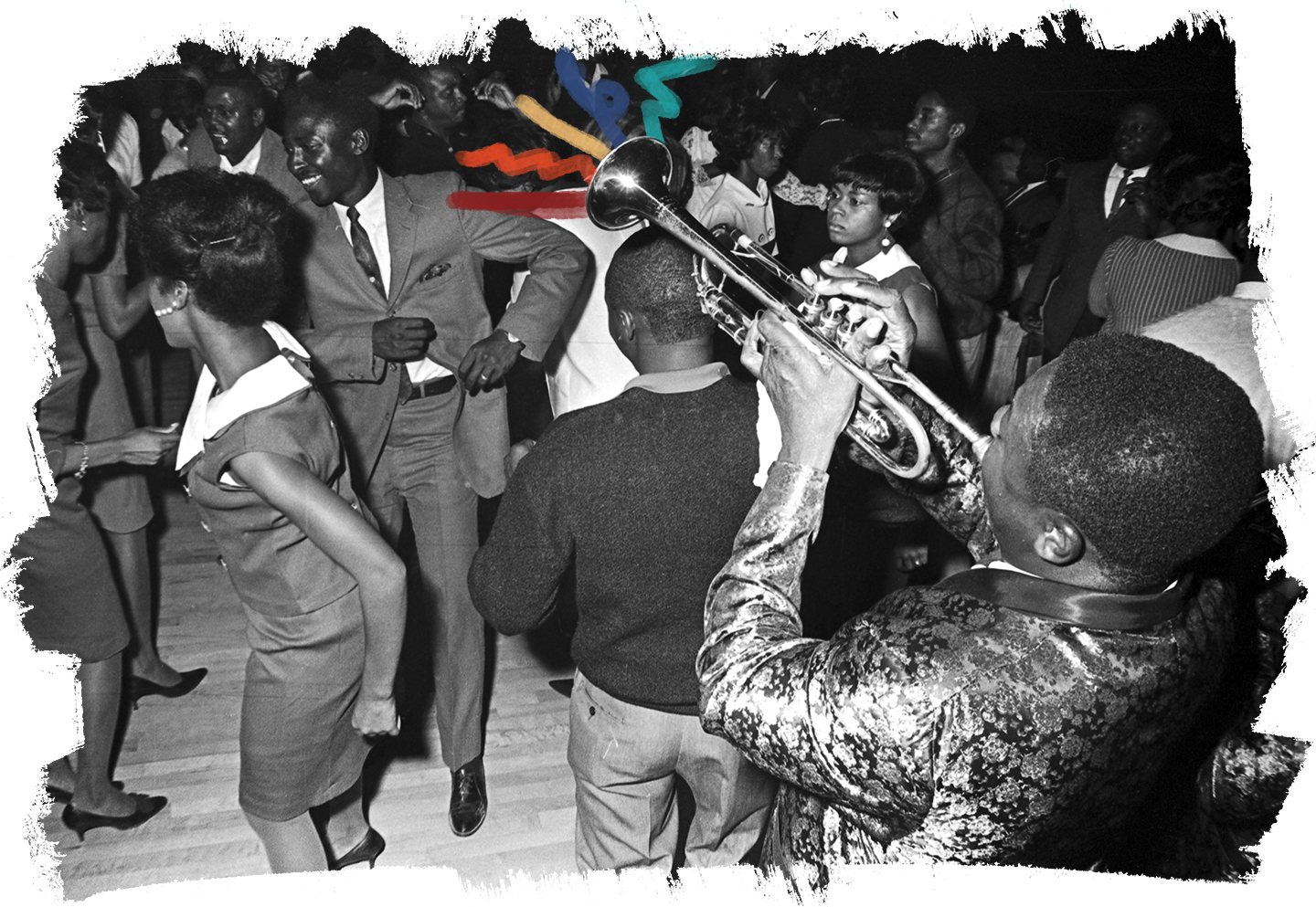"""Bennie """"Buckwheat"""" Payne of The Sheiks playing the trumpet on the floor in front of the stage at the Laicos Club in Montgomery, Alabama."""