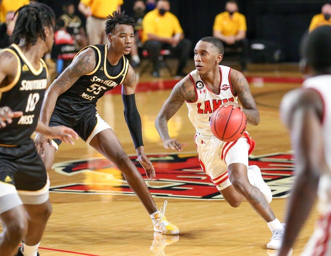 Junior guard Davion Buster drives toward the rim during Lamar's game against Southern Miss on Dec. 15, 2020, in Beaumont, Texas.