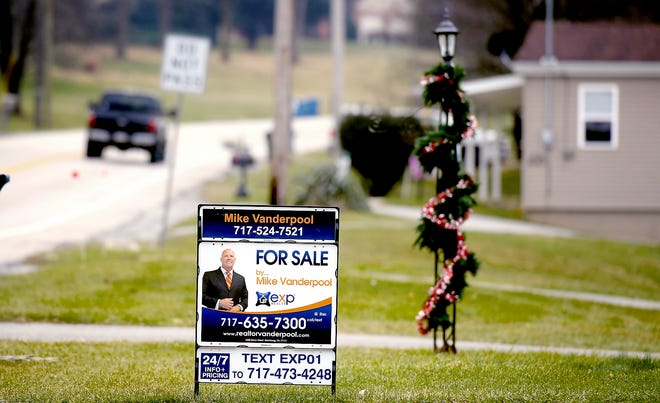 """A """"for sale"""" sign is visible outside a home in North Codorus Township Thursday, Jan. 14, 2021. Bill Kalina photo"""