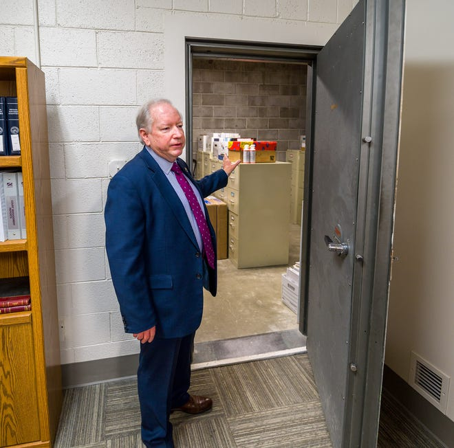 In this photo from January 2021, Robert Switzer, Yerington city manager, shows a munitions vault, previously used by the armory that has been repurposed as storage for administrative documents.