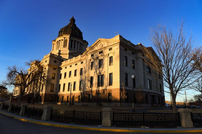Sun sets on the South Dakota State Capitol on Monday, January 11, in Pierre.