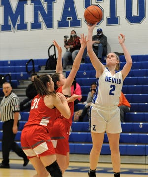 Zanesville's Madison Winland puts a shot up over a pair of Johnstown defenders, including Brooke Barb (31), in Wednesday's Licking County League contest. The Lady Devils won 37-25.