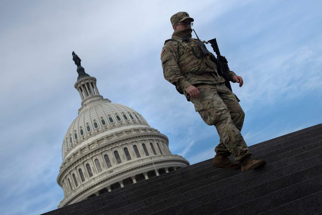 A member of the National Guard provides security at the U.S. Capitol on Jan. 14, 2021, in Washington, DC, a week after supporters of President Trump attacked the Capitol, and ahead of the inauguration of President-elect Joe Biden on Jan. 20.