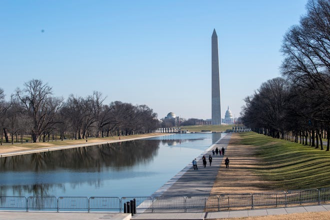 Security around the National Mall is heightened ahead of inauguration Day on Jan. 13, 2021, in Washington..