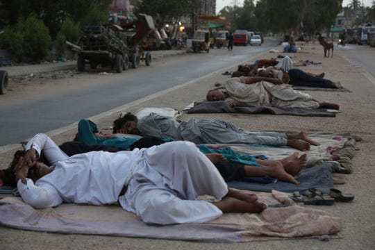 Karachi, Pakistan, sweltered through a heat wave in June amid what climate scientists say was one of the planet's hottest years on record.